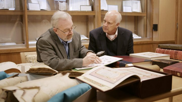 Steve and Del looking at a ancient text