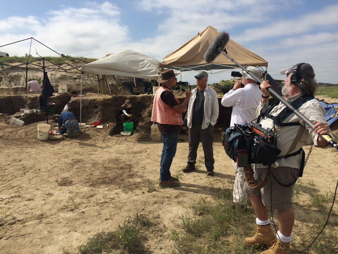 Art Chadwick and Del Tackett talking at a dig site