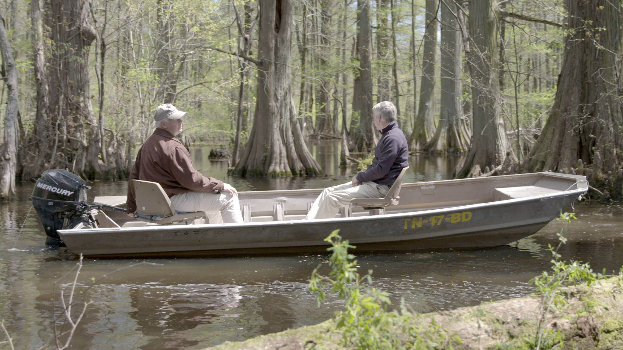 Stuart Burgess and Del Tackett in a boat on Reelfoot Lake